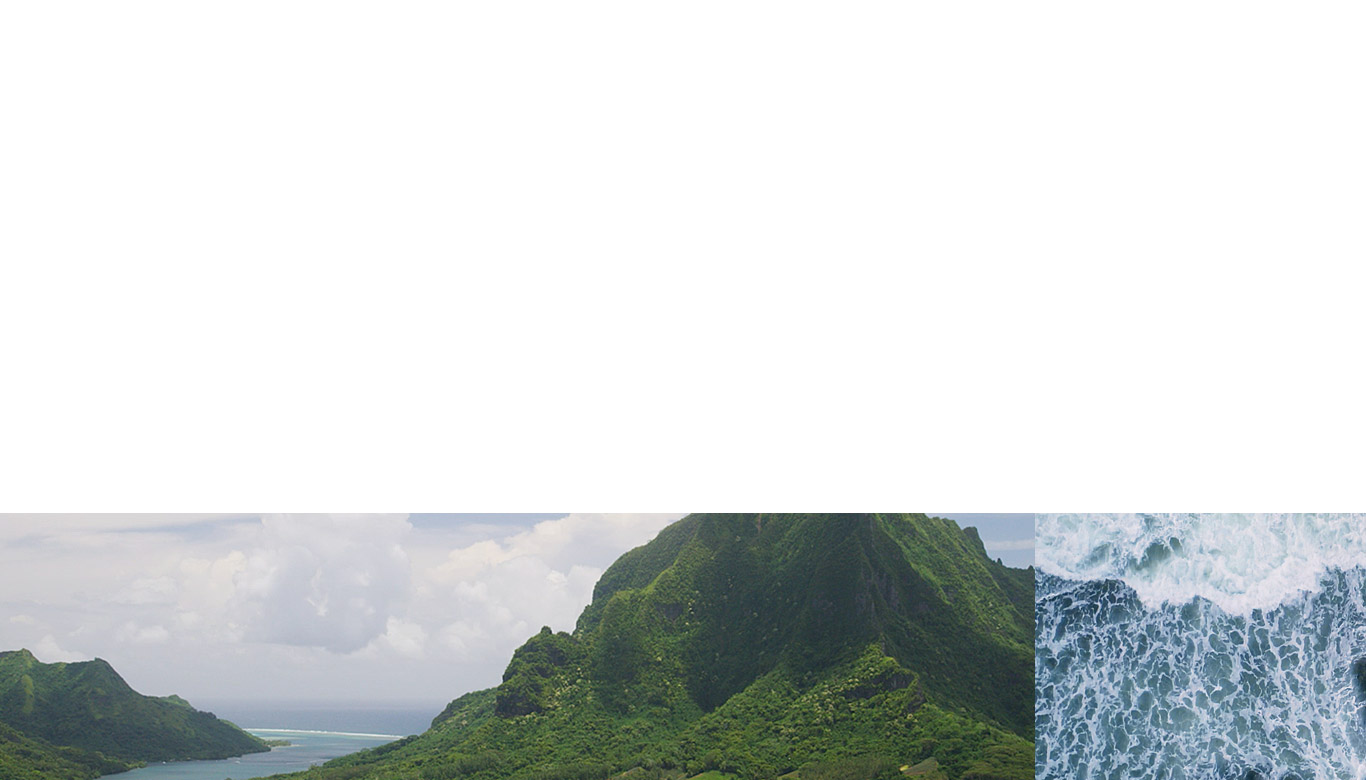 Photograph of lush green mountains and ocean.