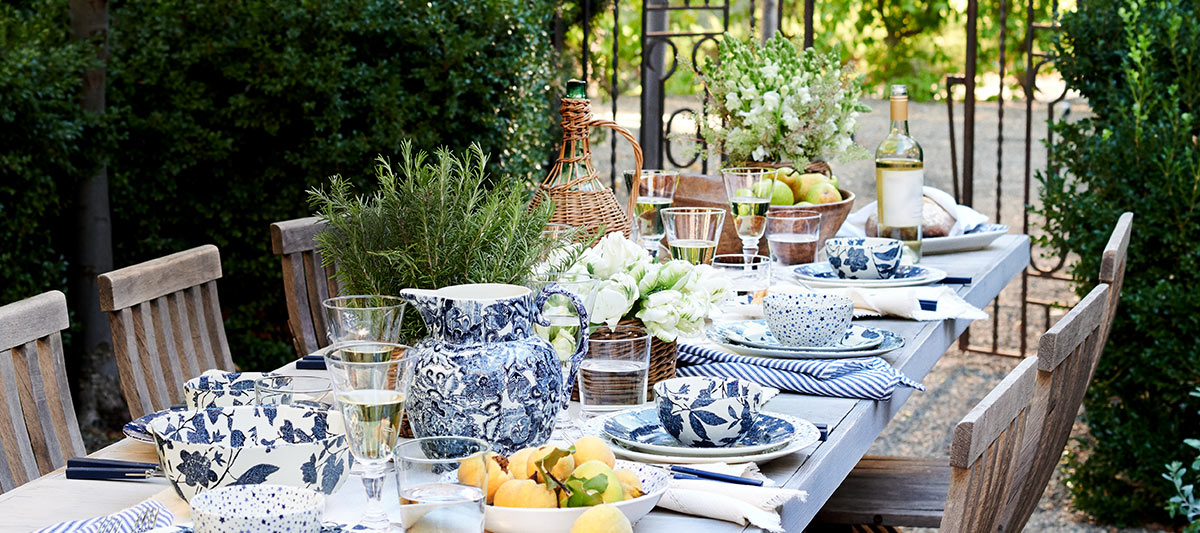 Outdoor table set with blue-and-white floral dishes and home-dining-serveware