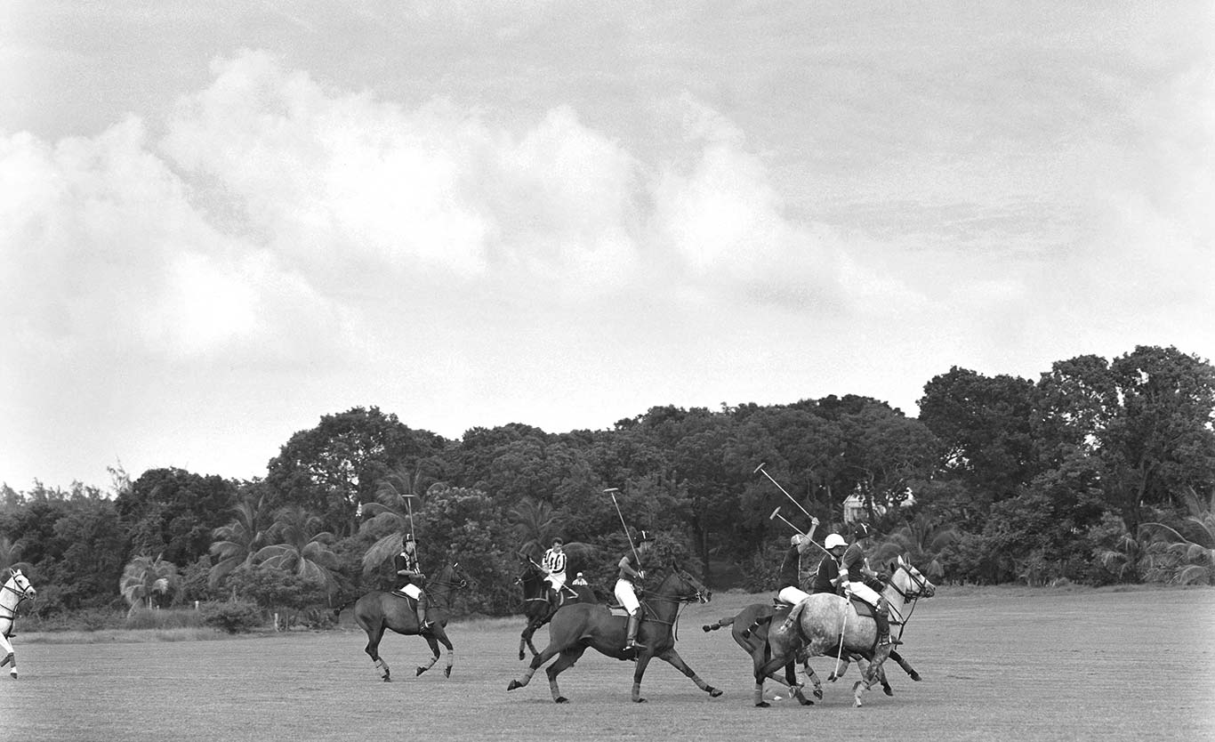 Greyscale image of polo match