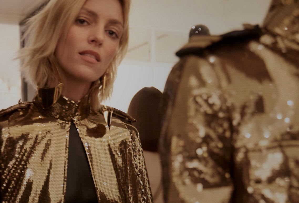 Models wearing gold-sequined jacket