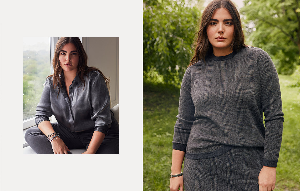 Woman wears grey sweater and matching skirt.