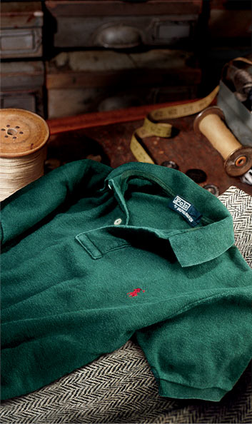 Photograph of vintage weathered green Polo shirt on trunk